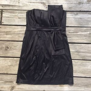 strapless black dress with bow on front